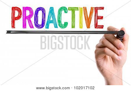 Hand with marker writing: Proactive