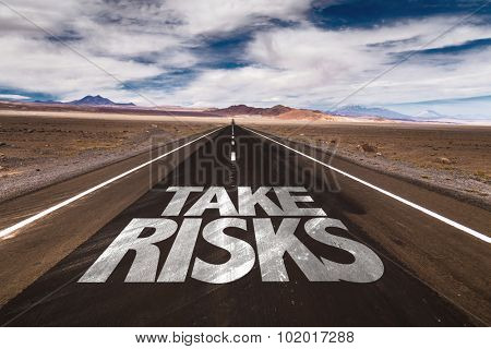 Take Risks written on desert road