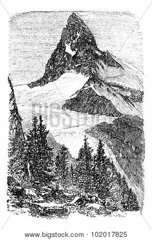 The Matterhorn mountain or Monte cervino, Zermatt, Switzerland vintage engraving. Old engraved illustration of beautiful Matterhorn with trees in the foreground.