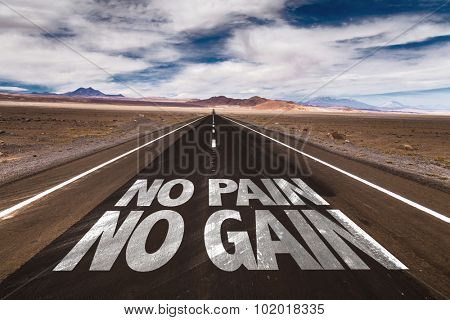 No Pain No Gain written on desert road