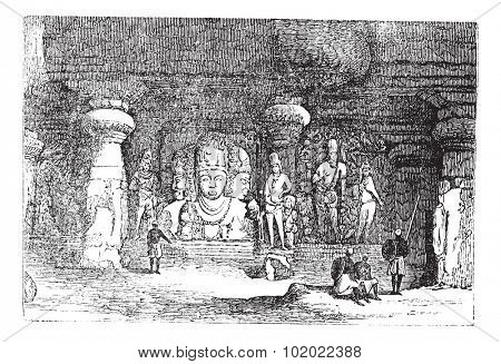 Elephanta Cave in Maharashtra, India, during the 1890s, vintage engraving. Old engraved illustration of an Elephanta Cave showing wall sculptures. Trousset encyclopedia (1886 - 1891).