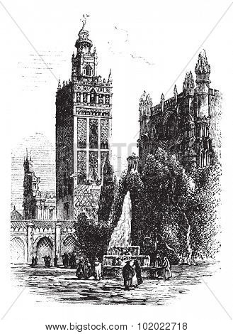 Giralda in Seville, Spain, during the 1890s, vintage engraving.  Old engraved illustration of Giralda with Cathedral of Seville. Trousset encyclopedia (1886 - 1891).