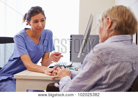 Senior Patient Having Consultation With Nurse In Office
