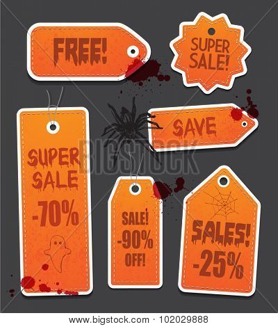 Orange grunge Halloween price sale tags isolated on black background