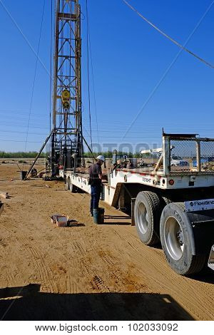Unloading Trailer in Oil Field