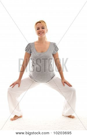 Beautiful Pregnant Woman Exercising