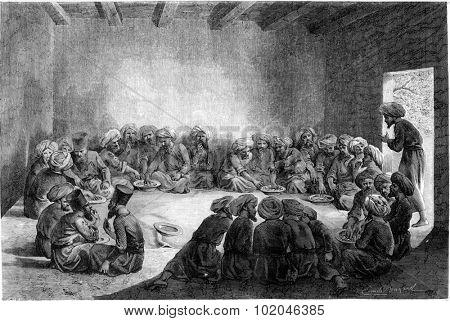 A meal at the Turkmen, vintage engraved illustration. Le Tour du Monde, Travel Journal, (1865).
