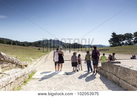 Ancient Ruins Of The Philippeion At Olympia, Greece. The Archaeological Museum Of Olympia, The Most
