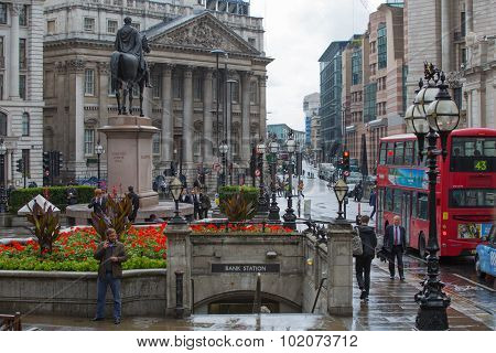 LONDON, UK - SEPTEMBER 17, 2015: City of London. Bank of England square view after the rain with lot