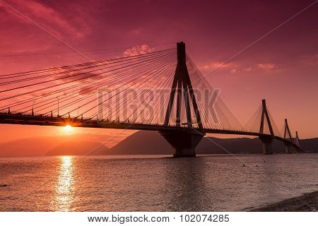 View Of The Bridge Rio-antirio In Greece, At Sunset.