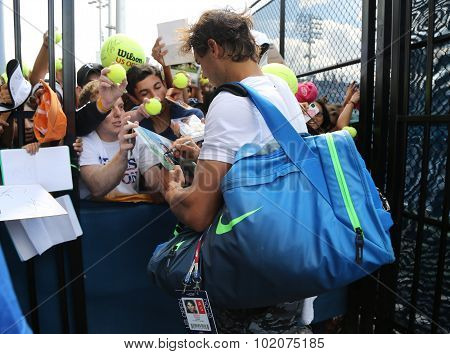 Fourteen times Grand Slam champion Rafael Nadal of Spain signing autographs after practice