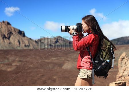 Nature Photographer taking pictures outdoors during hiking trip on Teide Tenerife Canary Islands. poster