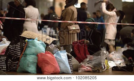 Female Aid Worker Distributing Clothes at Charity Collecting Point in Copenhagen Railroad Station