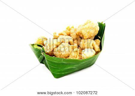 Thai Food Appetizer ,pork Snack, Pork Rind, Pork Scratching, Pork Crackling In Banana Leaf Bowl.