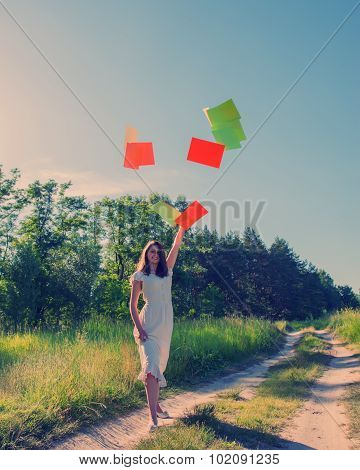 Girl Joyfully Threw Sheets Of Paper