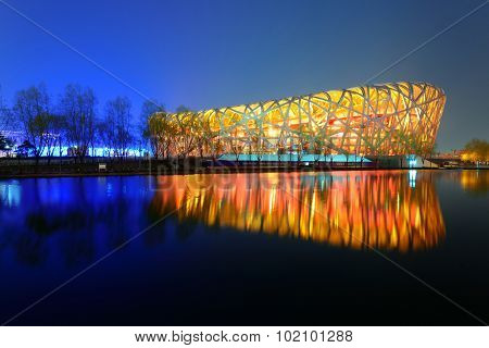 BEIJING, CHINA - APR 7: Beijing National Stadium at night on April 7, 2013 in Beijing, China. The stadium was established for the 2008 Summer and Paralympics.