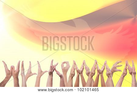 Word Welcome Formed With A Lot Of Hands, German Flag In The Background