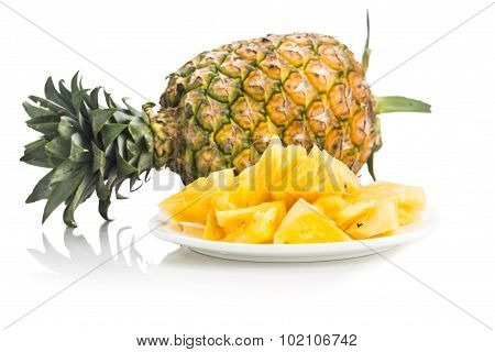 Fresh Juicy Nutritious Cut Pineapple With Whole Fruit As Background.