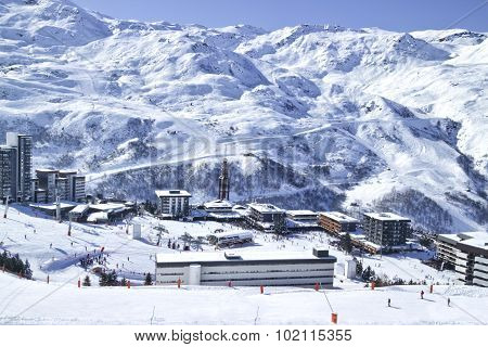 Winter Snowy High mountain panorama of French ski resort of Les Menuires in 3 Valleys with the ski l