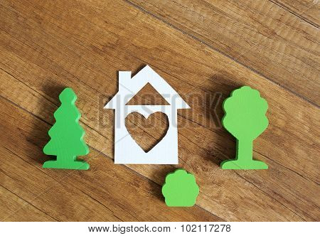 house with a window in the form of heart symbolizing the parental home. shapes of trees as a symbol of the parents, and shrubbery as a symbol of the rising generation poster