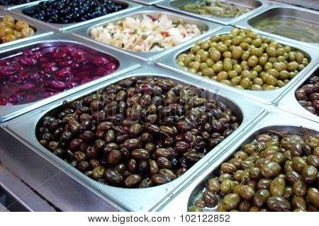 Photo of Olives on display in the market.