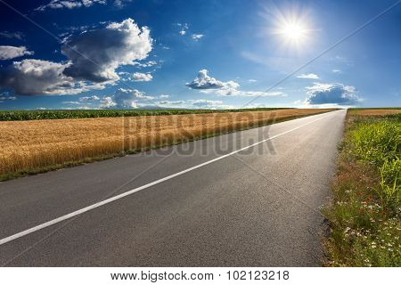 Driving On An Empty Asphalt Road At Sunny Day