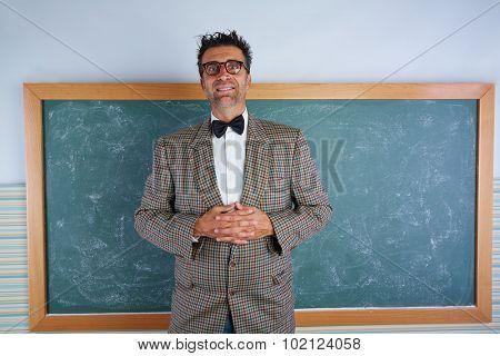 Nerd silly teacher vintage retro suit and braces on blackboard