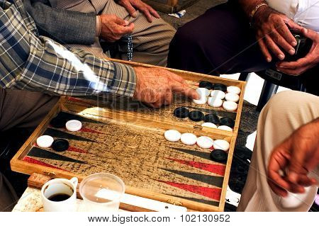 JERUSALEM, ISRAEL - SEPTEMBER 10: People play backgammon game on September 10 2005 in Jerusalem Israel. Backgammon is one of the oldest board games for two players in the world.