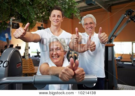 Happy Fitness Team In Gym