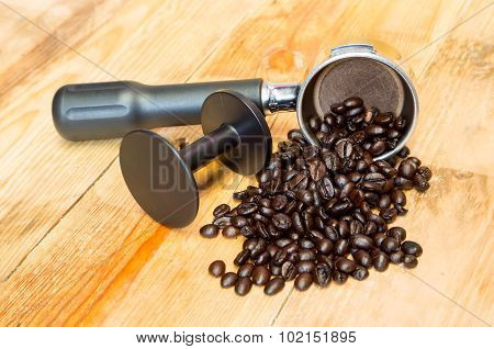 An Espresso Machine Group Head And Coffee Beans With Tamper.