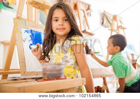 Hispanic Girl Painting In Art Class