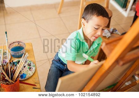Little Boy Working On A Painting