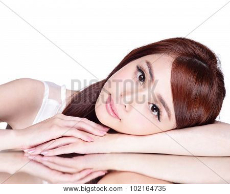Beautiful face skincare beauty woman lying down with mirror reflection isolated on white background. asian beauty model poster