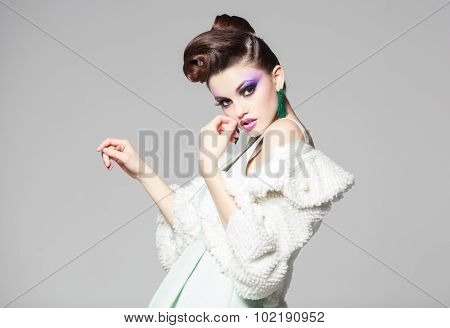 Beautiful Woman Portrait Wearing White Dress And Fur