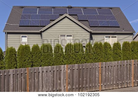 Solar Panels On A Roof Of A House.