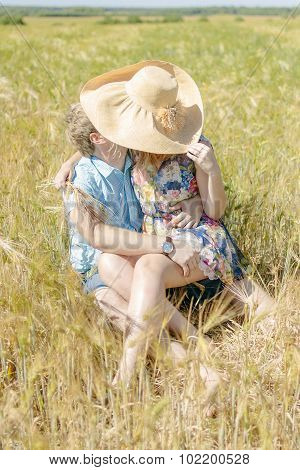 young loving couple on wheat field