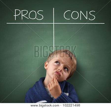 Child thinking with Pros and Cons on a blackboard concept for choice, for and against, confusion, inspiration and solution