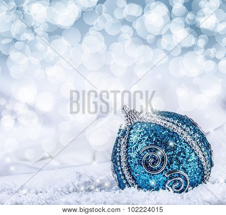 Christmas.Christmas blue balls  snow and space abstract background.