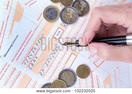 Female Hand Filling Remittance Slip