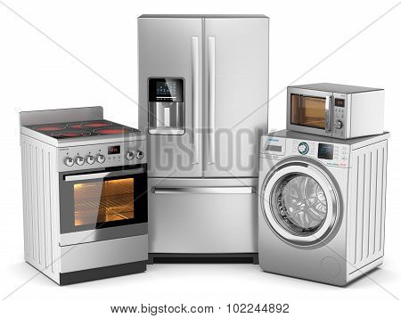 Home Appliances. Group Of Silver Refrigerator, Washing Machine, Electric Stove, Microwave Oven Isola
