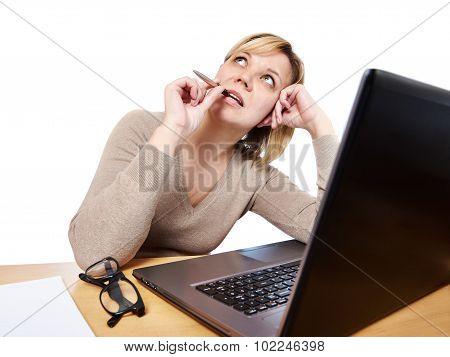 Beautiful Woman Dreams At Work Near Office Computer
