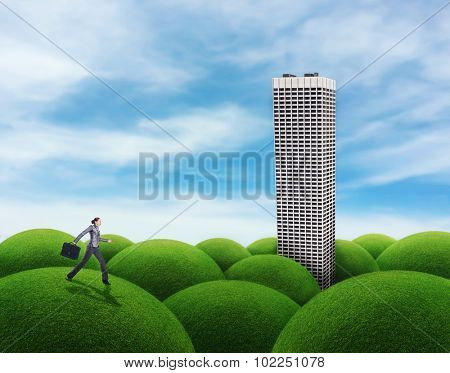 Woman running to the building