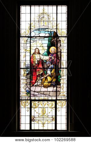 ZAGREB, CROATIA - MAY 28: Jesus and the centurion. Lord, I am not worthy to have you come under my roof..., stained glass window in the Basilica of the Sacred Heart of Jesus in Zagreb on May 28, 2015
