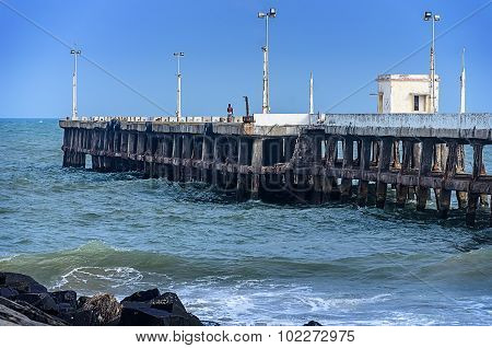Pier at the oceanside in Pondicherry. Tamil Nadu, India