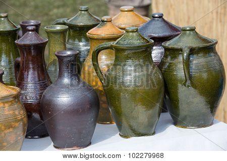 handmade ceramic pottery in a roadside market poster