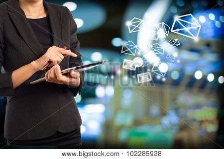 Business Woman Sending Email By Using Digital Tablet. Business Woman Sending Email By Using Digital Tablet. poster