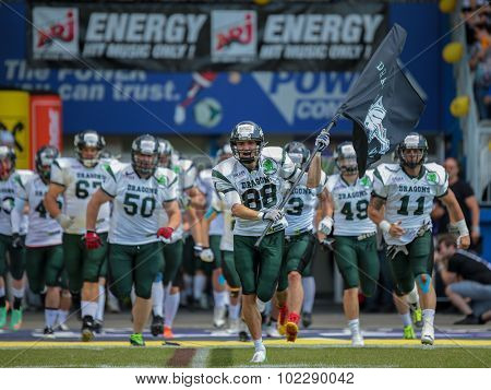 VIENNA, AUSTRIA - JUNE 22, 2014: WR Johannes Prammer (#88 Dragons) leads the team of the Danube Dragons into the stadium.