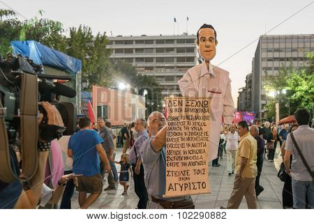 Athens, Greece 18 September 2015. Protestant with a caricature of Alexis Tsipras giving an interview