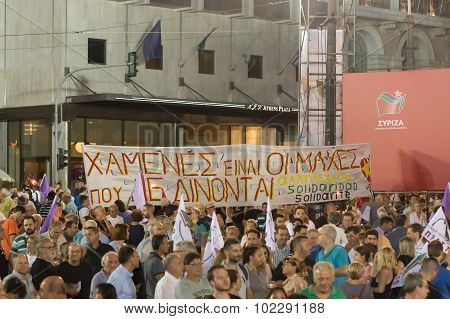 People hearing the speech of Alexis Tsipras.
