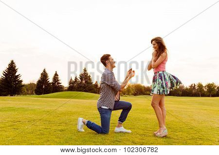 Young Man Makes A Proposal Of Betrothal To His Girlfriend